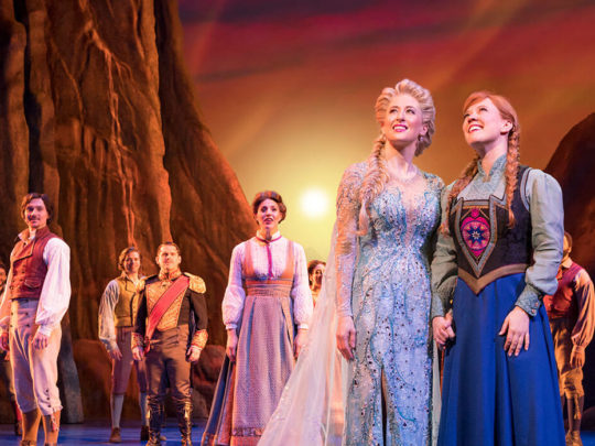 Caissie Levy (Elsa), Patti Murin (Anna) and the Company of FROZEN on Broadway. Photo by Deen van Meer.
