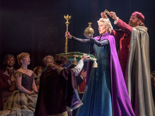Patti Murin (Anna) and Caissie Levy (Elsa) with Jacob Smith in FROZEN on Broadway. Photo by Deen van Meer.